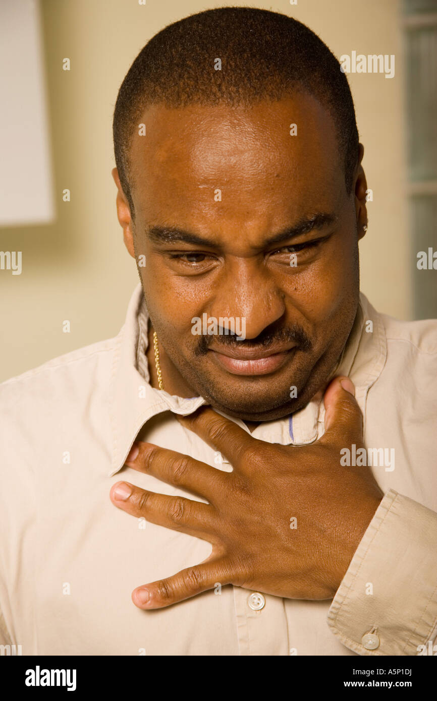 Man not feeling well. - Stock Image