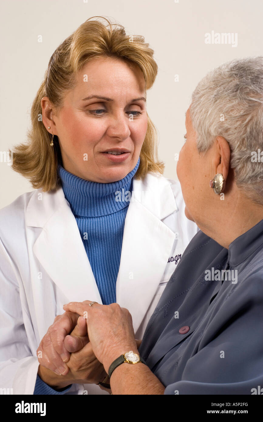 A compassionate healthcare professional listens to her patient. Stock Photo