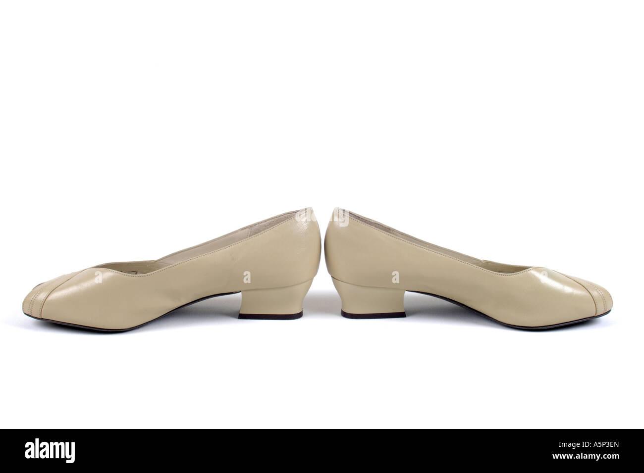 Informal Womans wedge heel shoes. - Stock Image