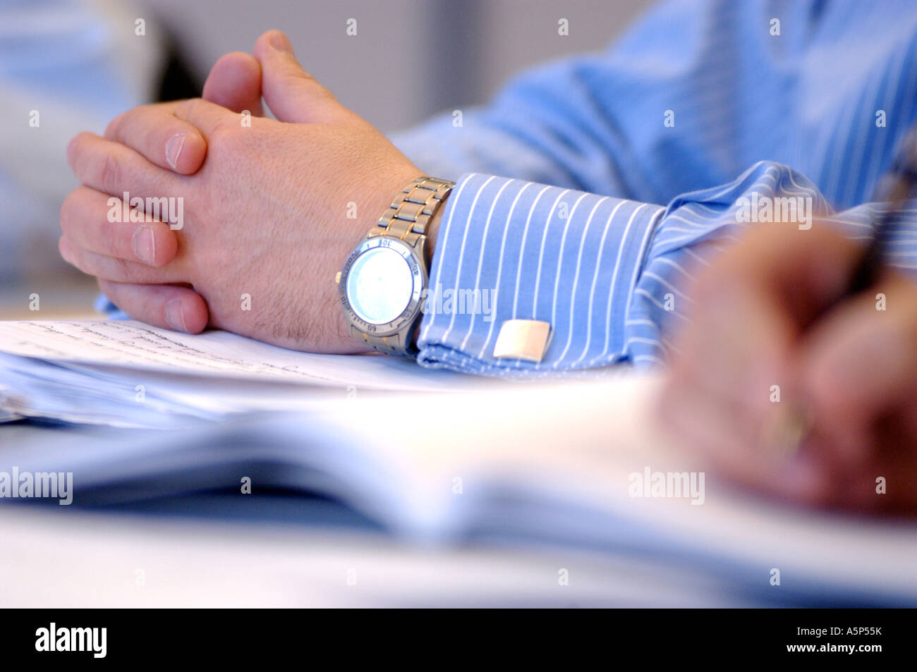 British business man hands in meeting London UK - Stock Image