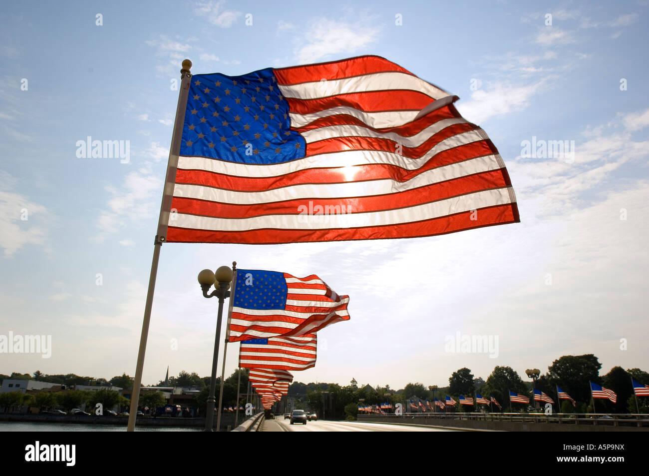 American flags on bridge, Westport, Ct. USA. - Stock Image