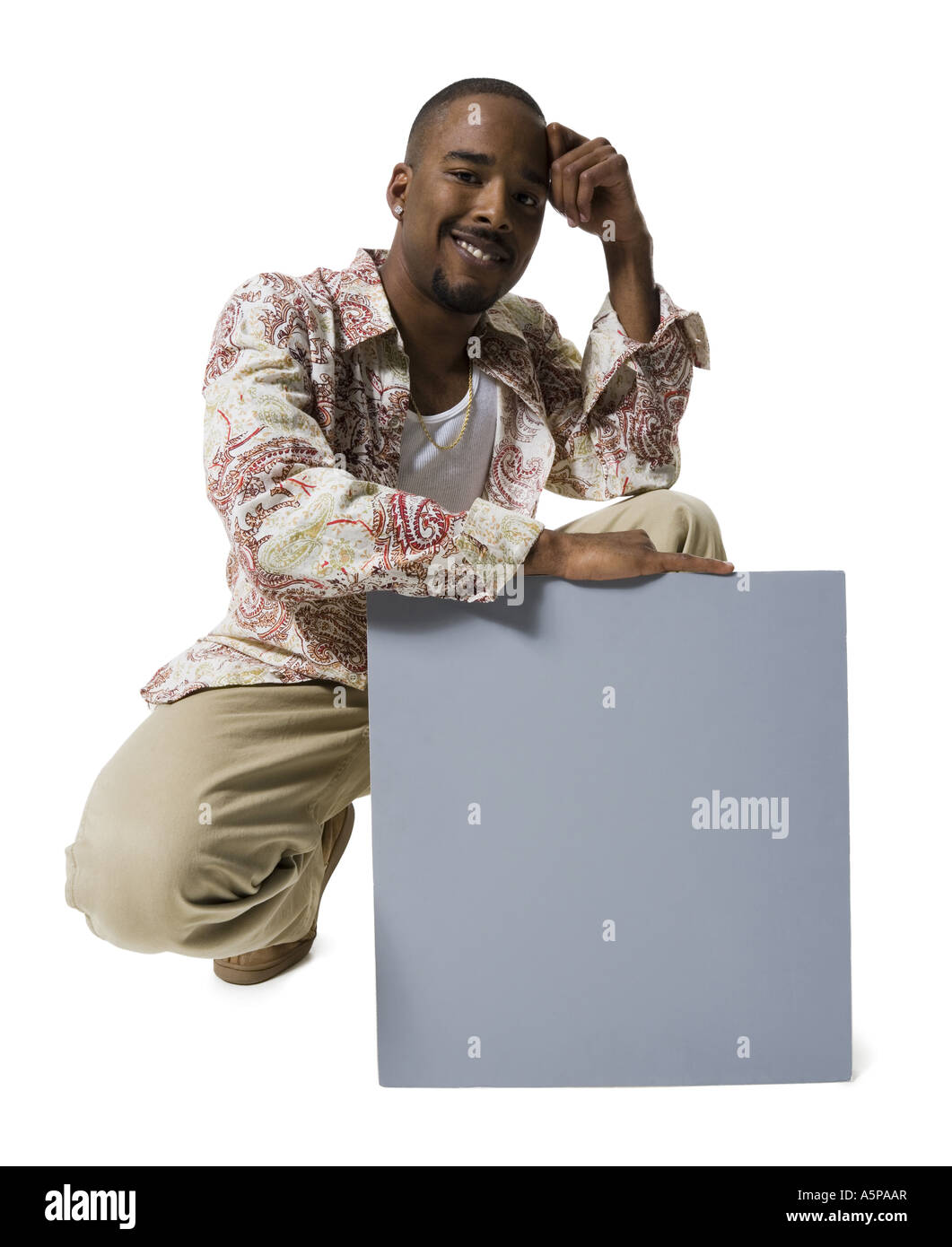 African American man holding a blank sign - Stock Image