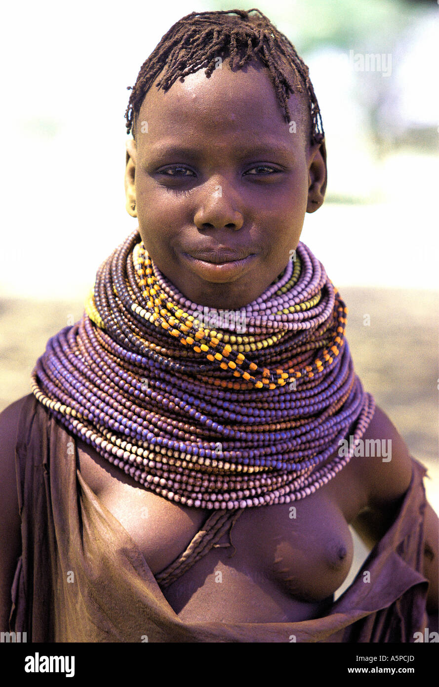 Young Turkana woman wearing typical blue bead necklaces ...