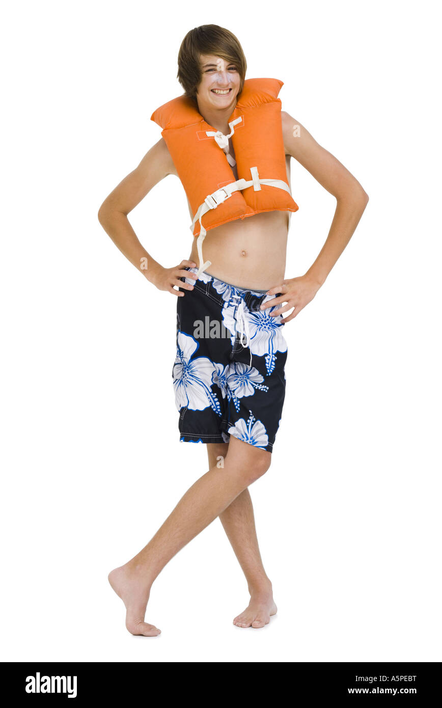 Boy in swim trunks with life vest Stock Photo