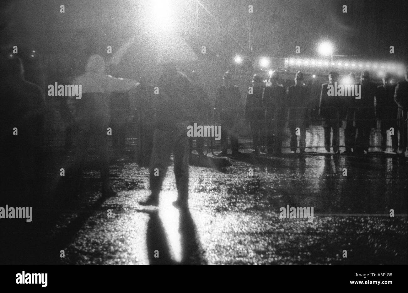 Confrontation between sacked journalist and police in a rain sodden demonstration during the Wapping dispute April Stock Photo