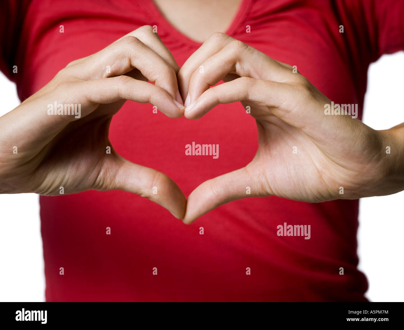 Woman Making A Heart Shape Symbol With Her Hands Stock Photo