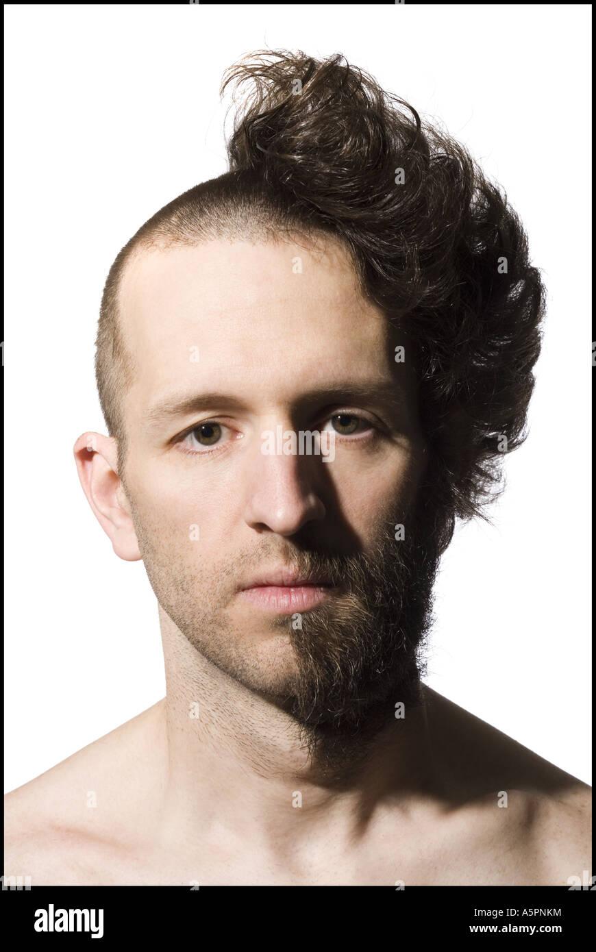 Man with half shaved head and beard Stock Photo - Alamy
