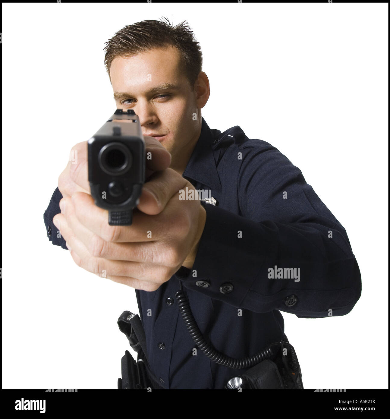 Male police officer with handgun - Stock Image