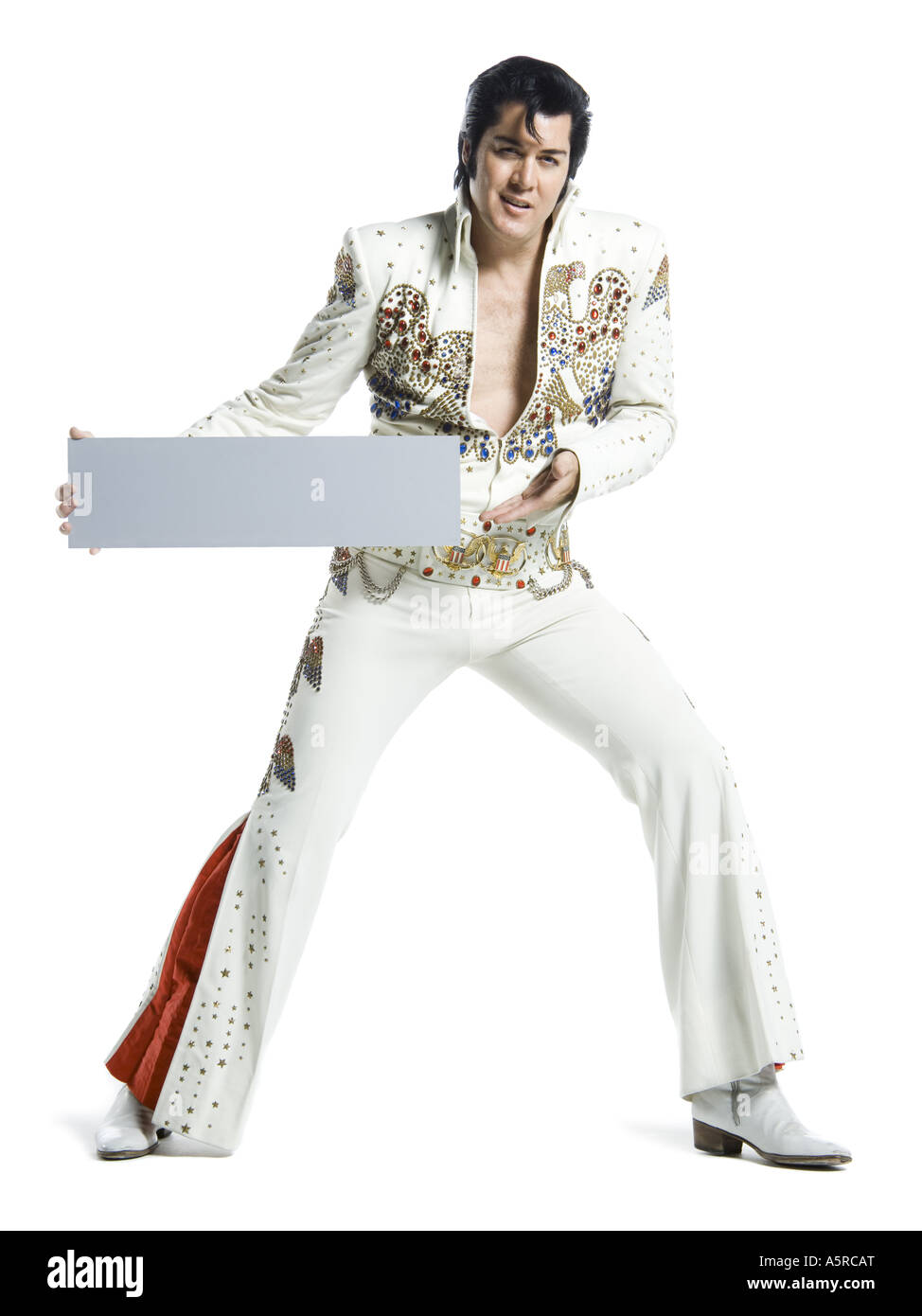 Portrait of an Elvis impersonator holding a blank sign Stock