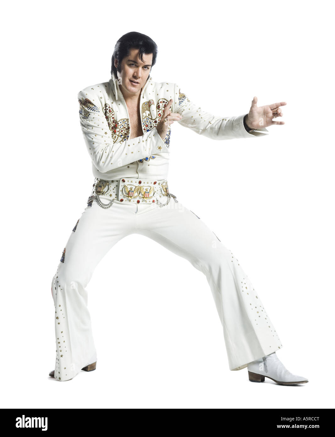 An Elvis impersonator dancing Stock Photo: 11372183 - Alamy