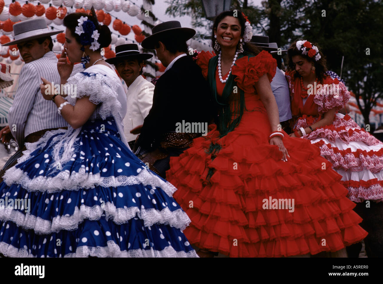 6727655c1daa SEVILLE FAIR, MEN IN TRADITIONAL SPANISH STYLE RIDING CLOTHES WOMEN IN FLAMENCO  DRESSES RIDE TWO UP ON HORSES, SEVILLE, SPAIN
