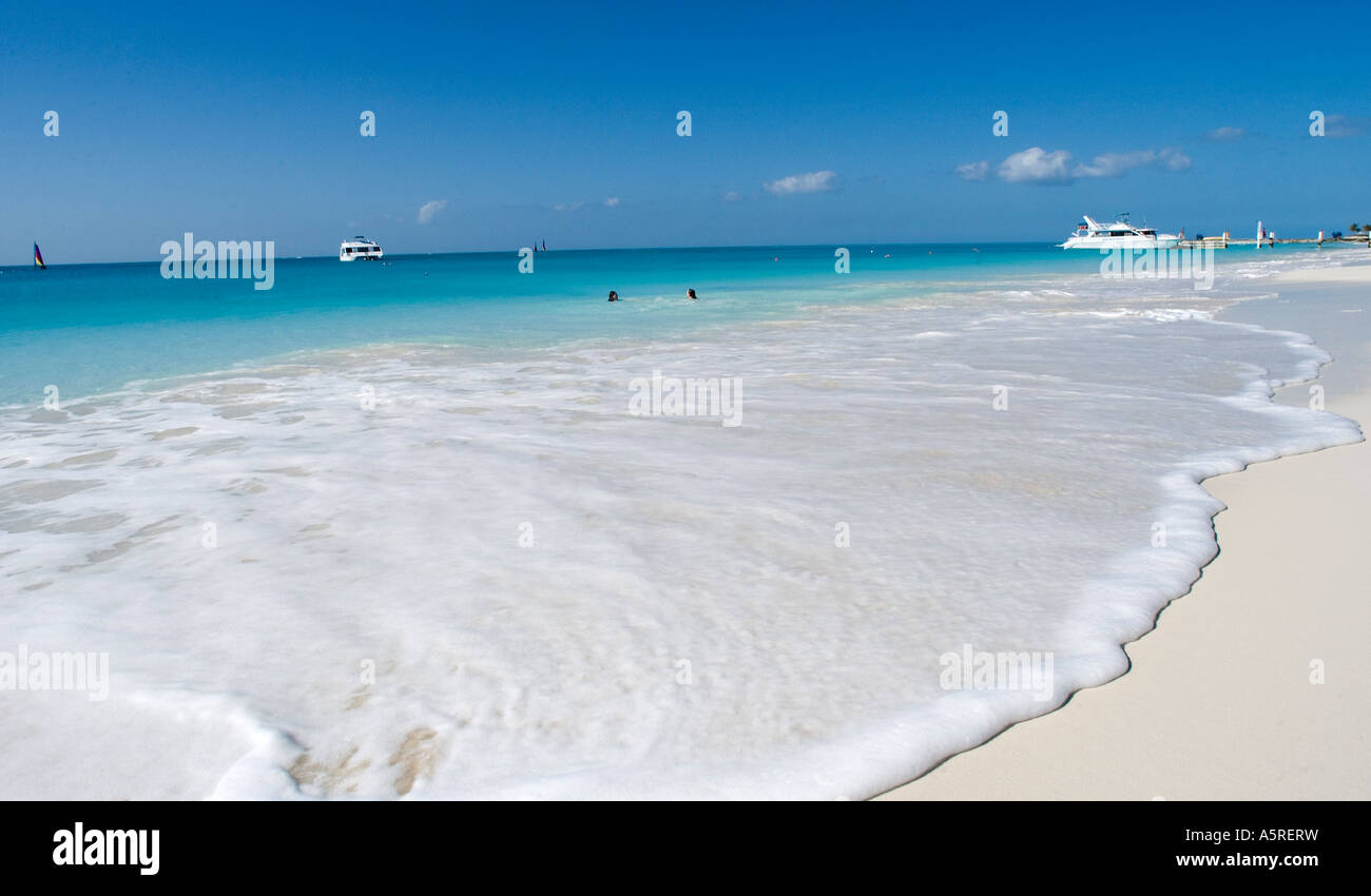 AQUAMARINE WATER AND GENTLE SURF MARK A PEACEFUL DAY ON GRACE BAY ON THE ISLAND OF PROVIDENCIALES TURKS AND CAICOS - Stock Image