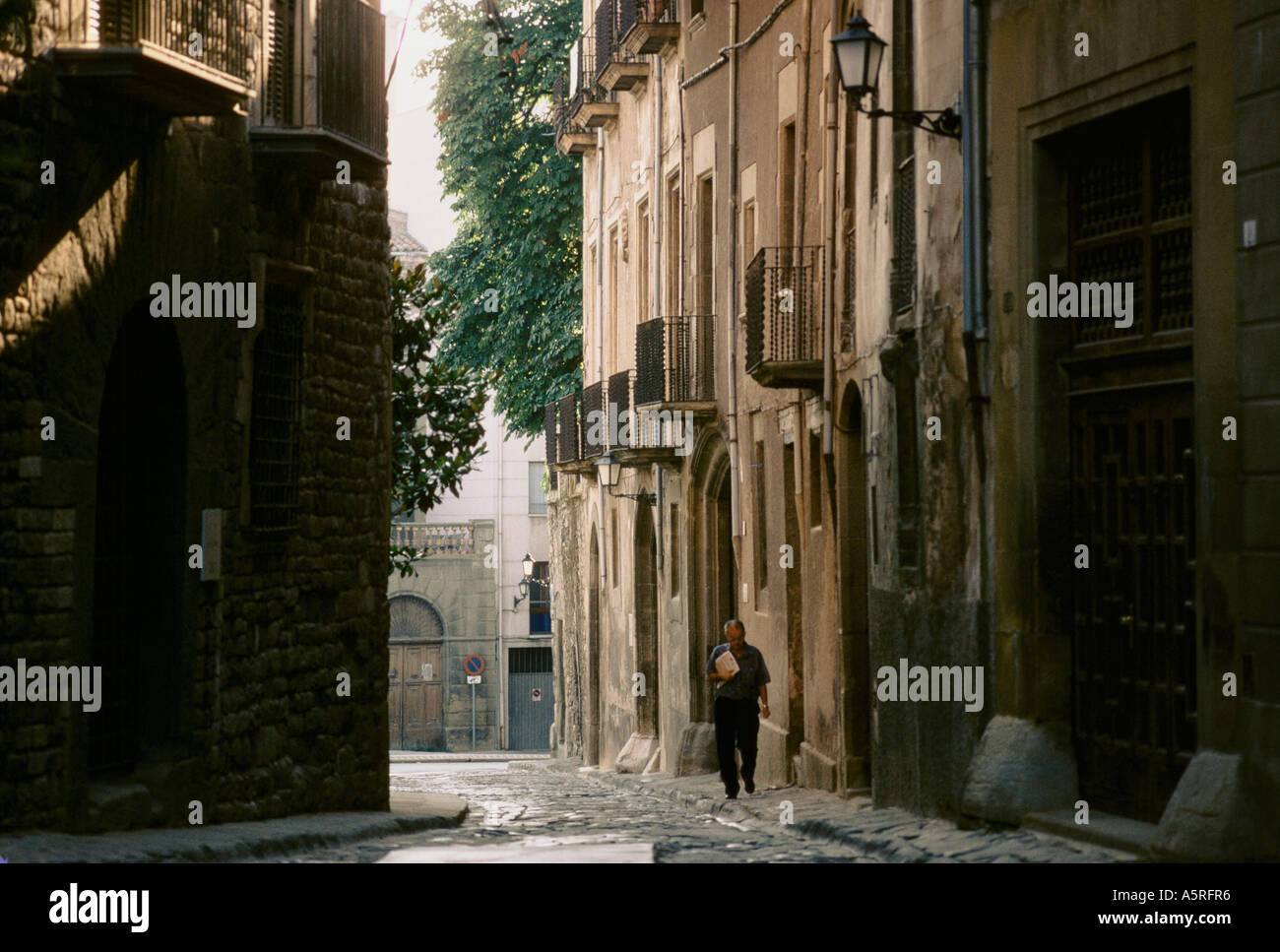 MAN WALKING IN THE OLD TOWN OF VIC, CATALUNYA SPAIN - Stock Image