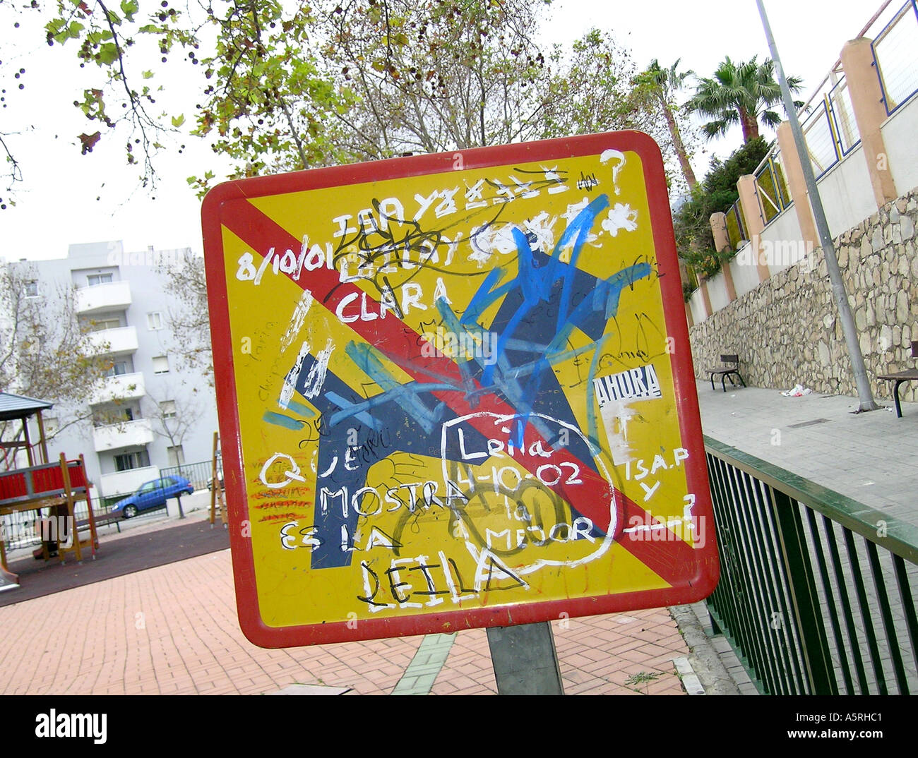 Defaced municipal sign saying Dogs Forbidden - Stock Image