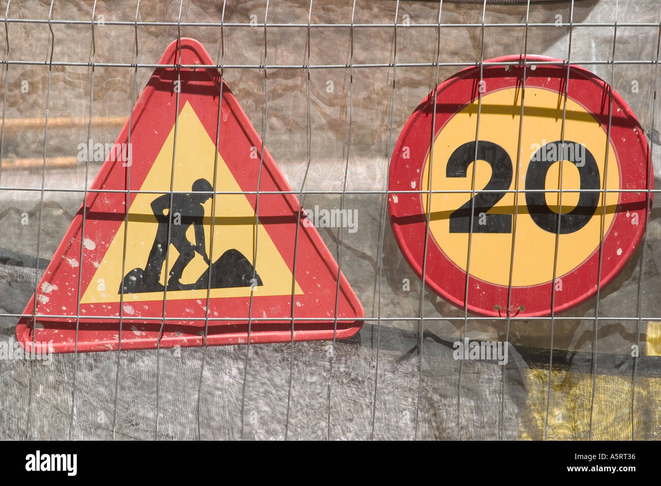 Traffic signs Men at work and 20 kilometers per hour speed limit - Stock Image