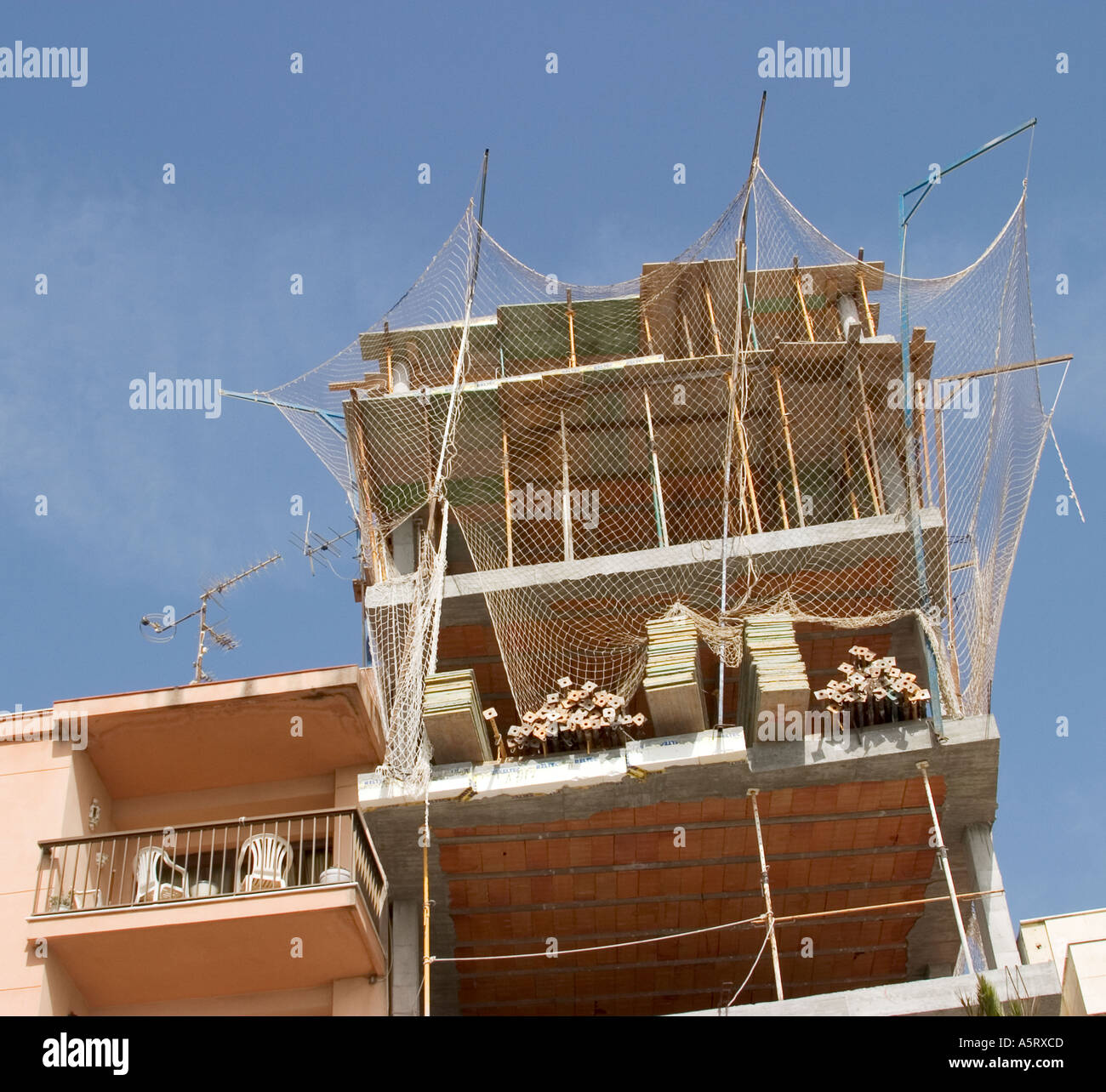 New construction beside completed building - Stock Image