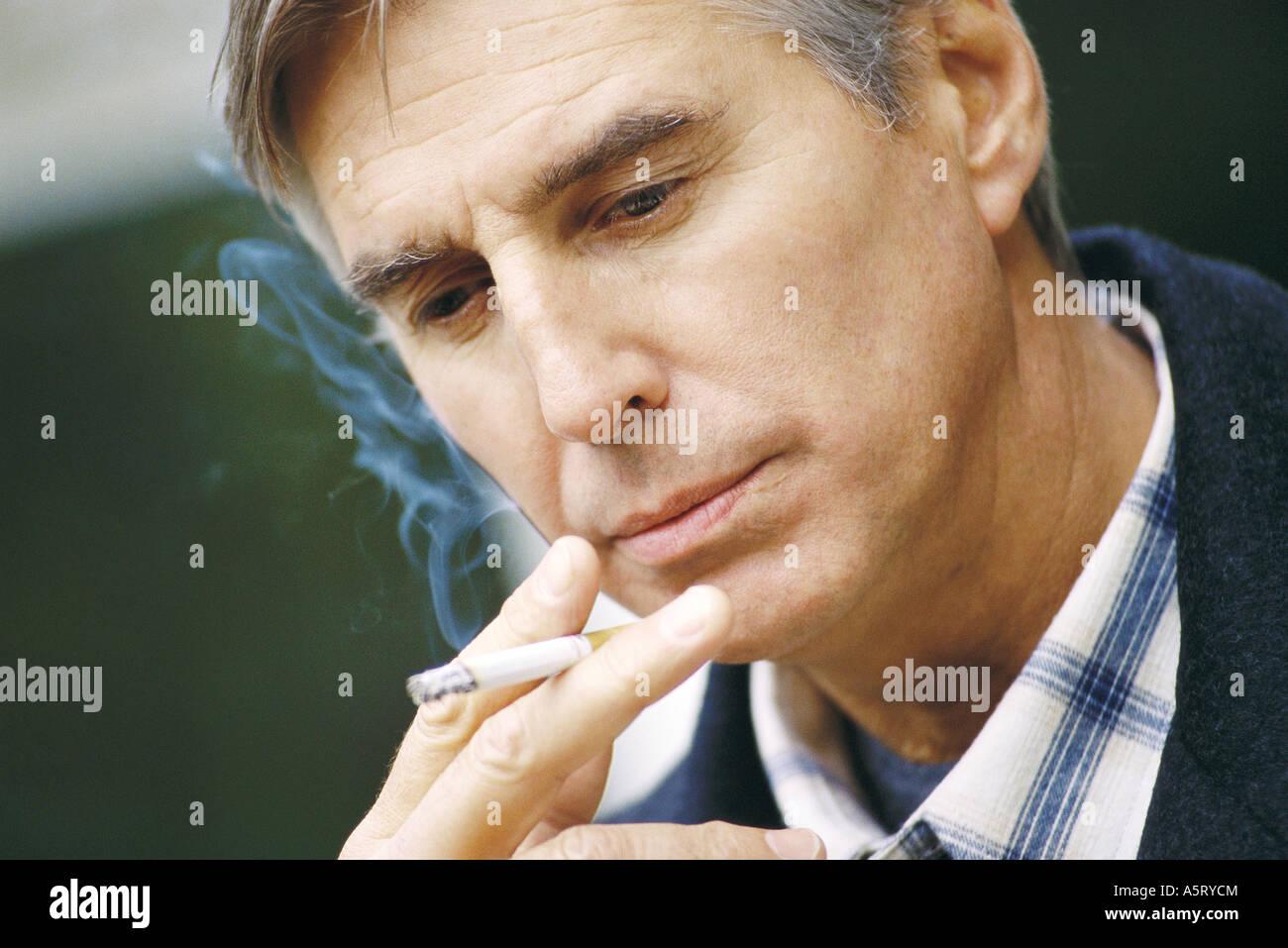 Senior man smoking - Stock Image