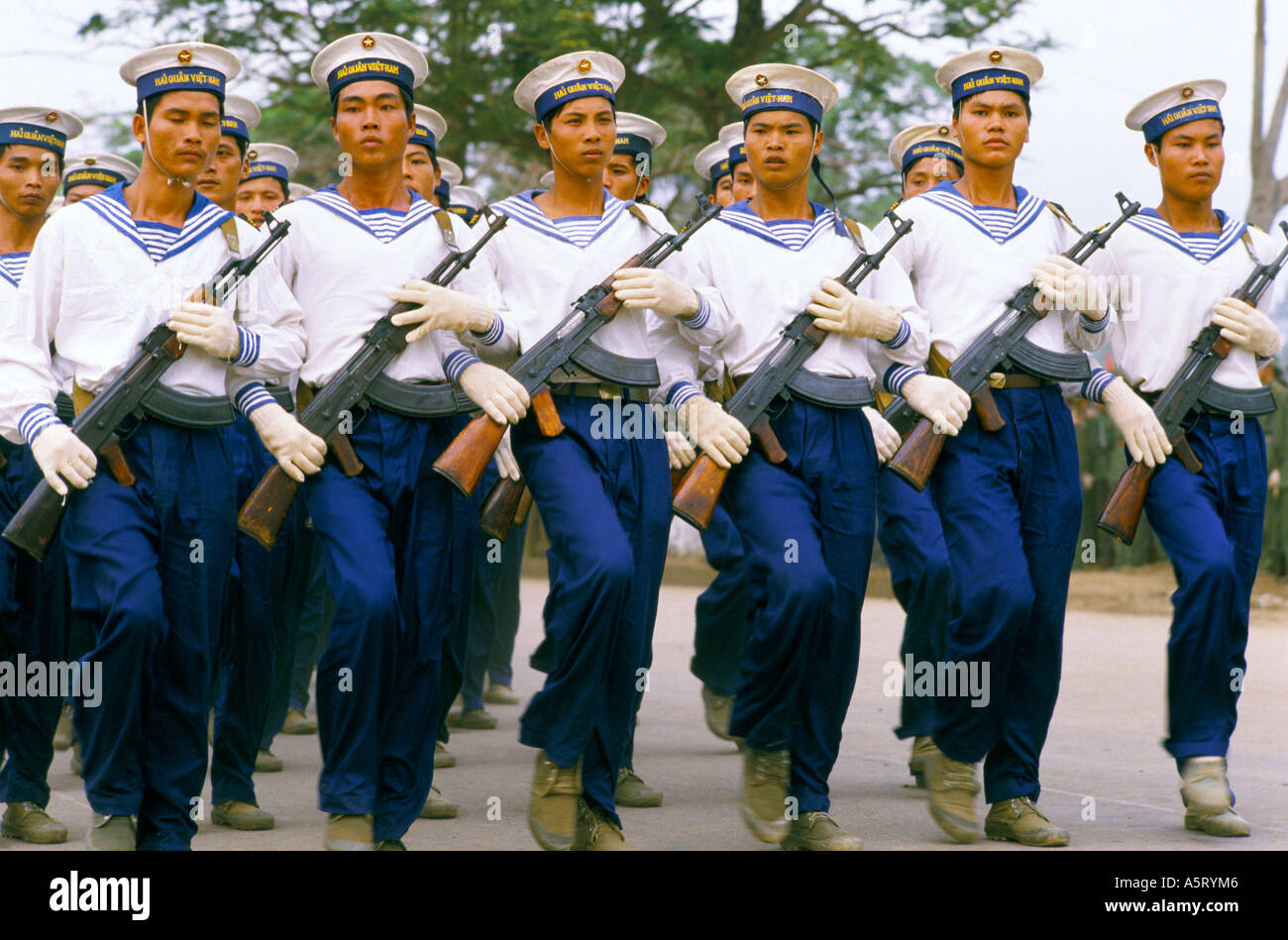 VIETNAM ,THE MARINES MARCHING WITH RIFLES TO MARK THE ENDING OF THE VIETNAM WAR - Stock Image