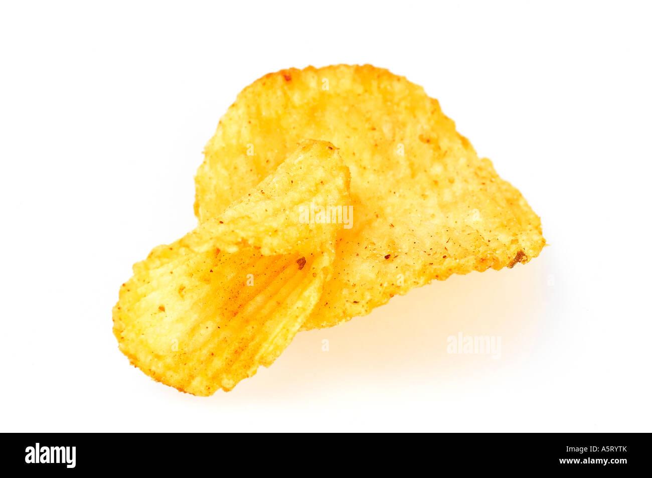 Flakes of crisps on white background - Stock Image