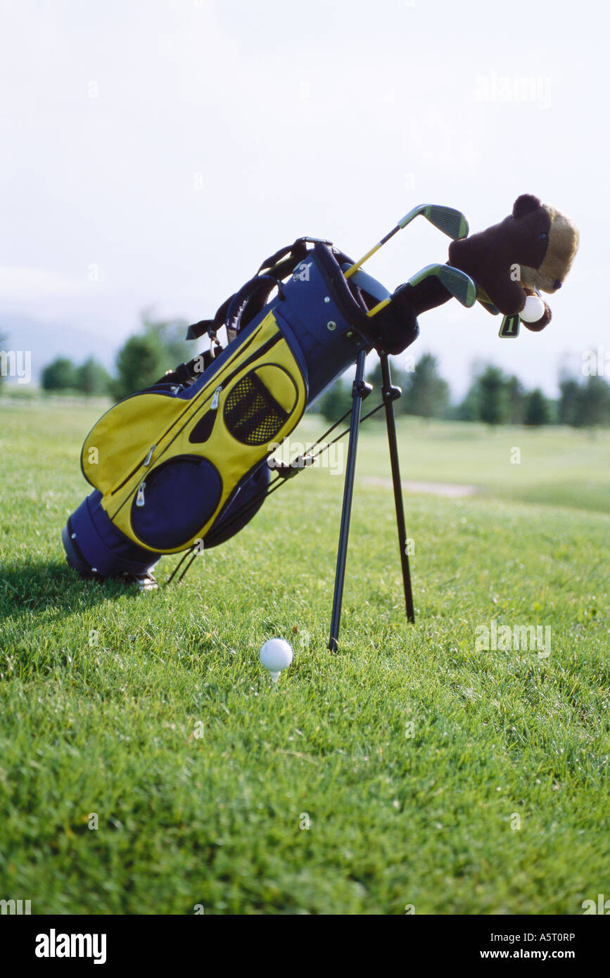 Golf bag propped up on golf course Stock Photo