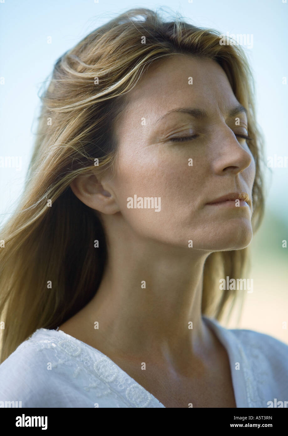 Woman, eyes closed, portrait - Stock Image