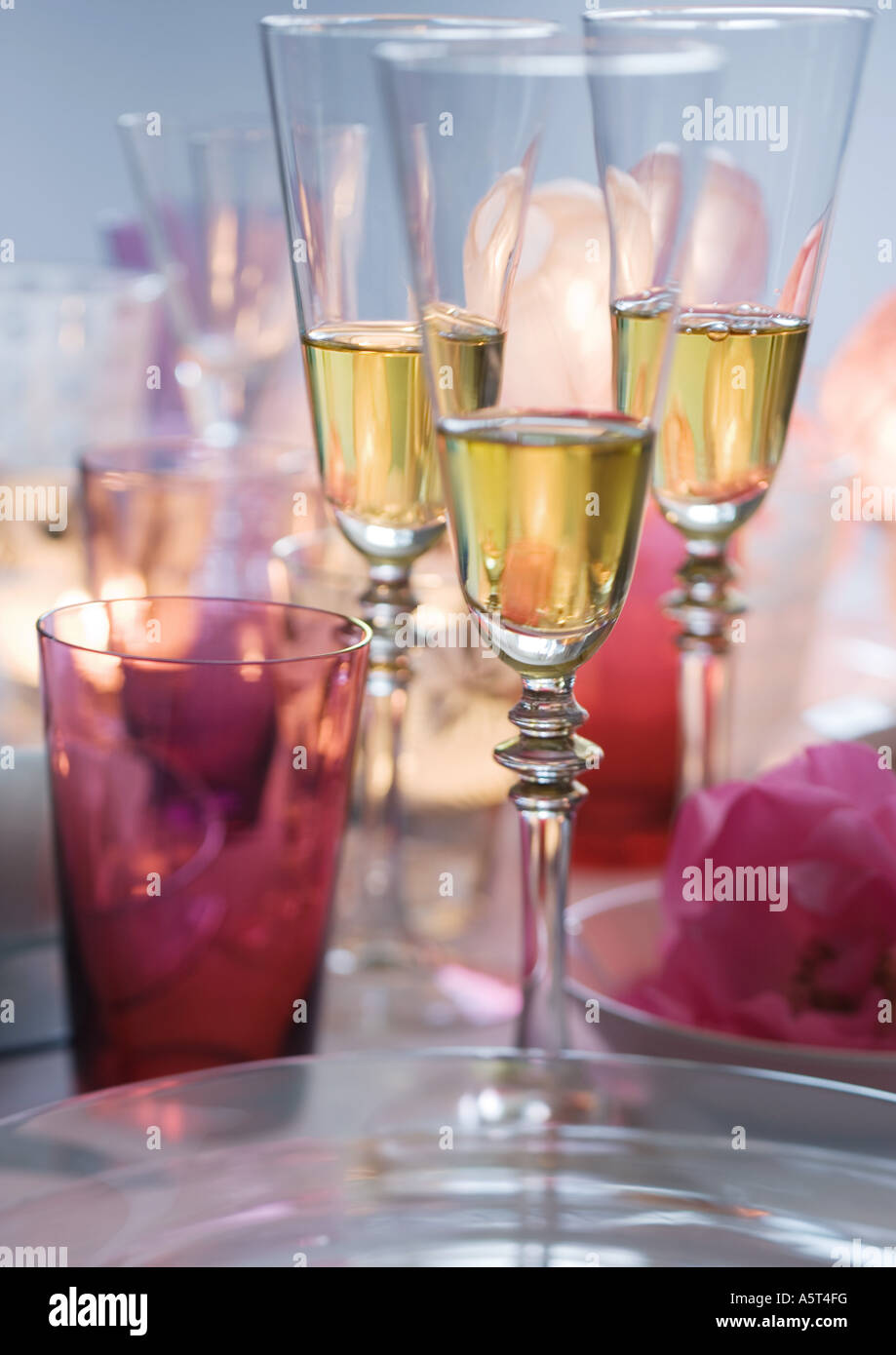 Glasses of champagne on set table - Stock Image