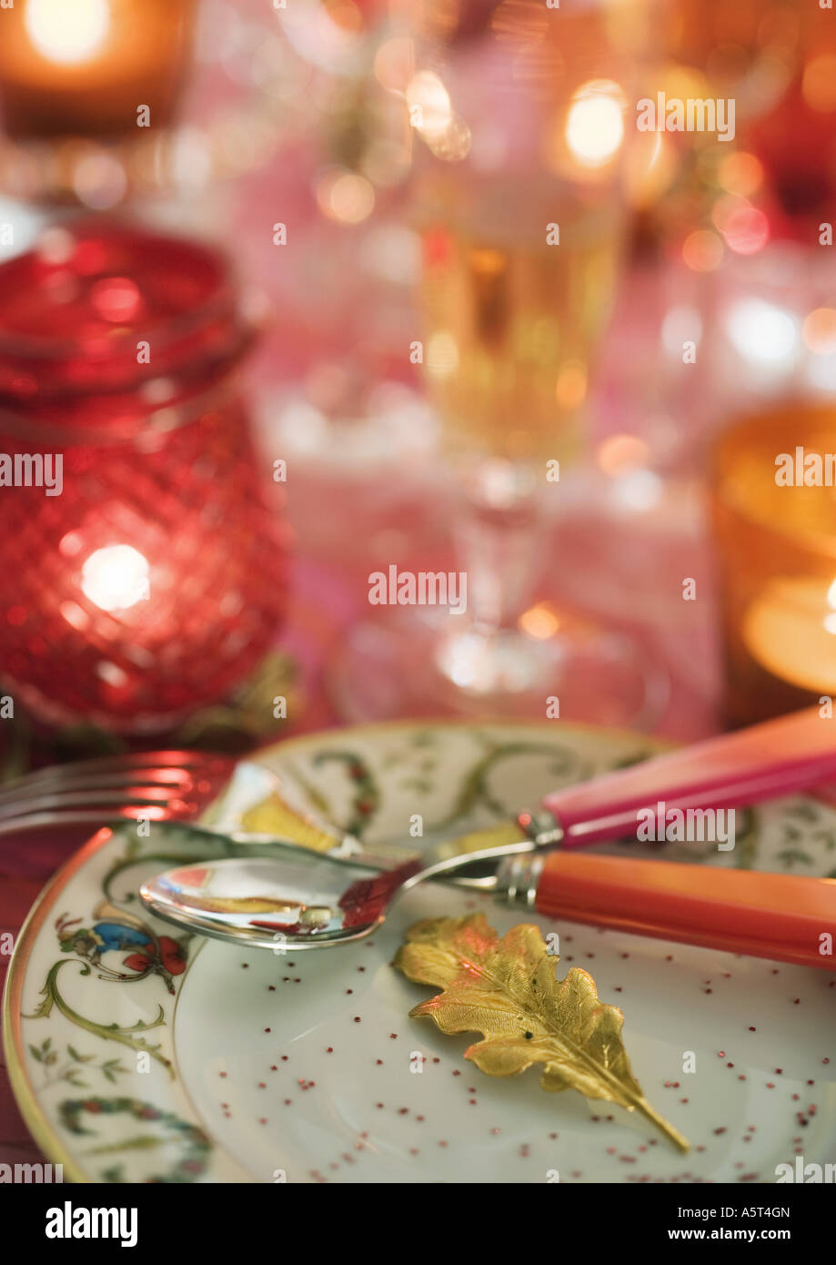 Decorated table with place settings - Stock Image