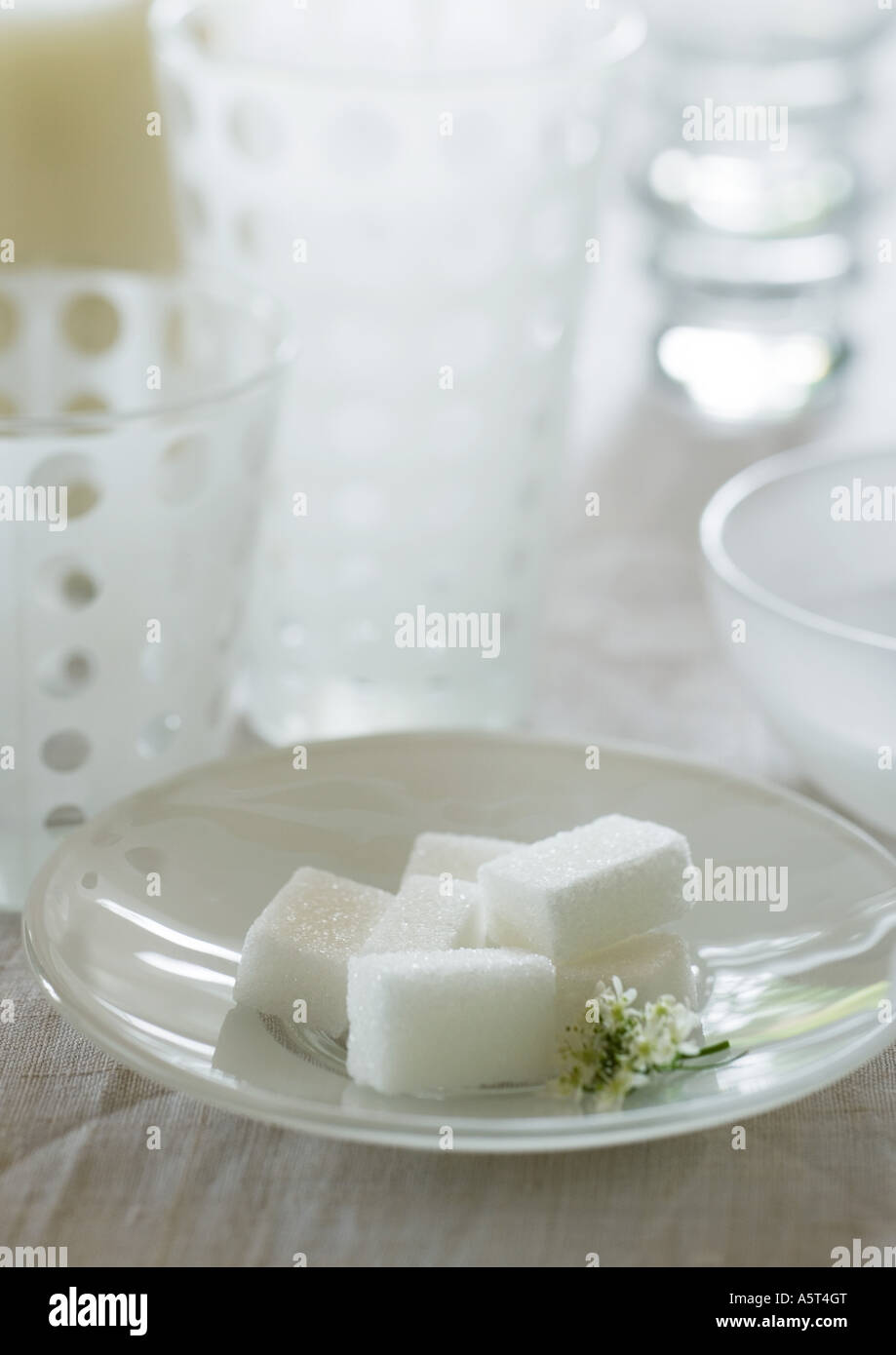 Sugar cubes in saucer - Stock Image