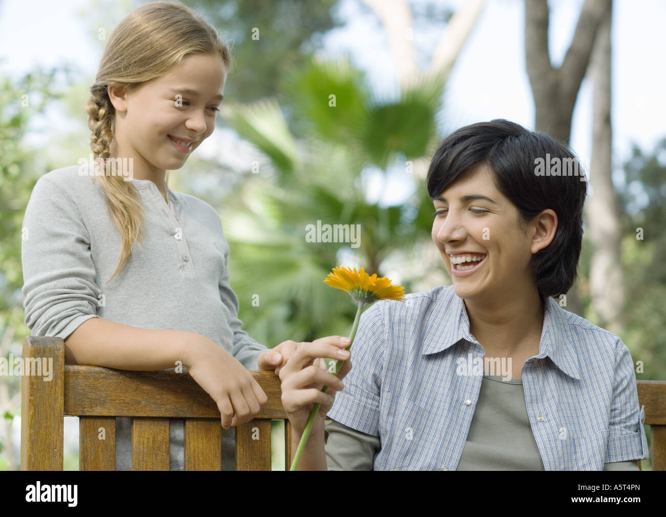Mother and daughter, mother holding flower - Stock Image