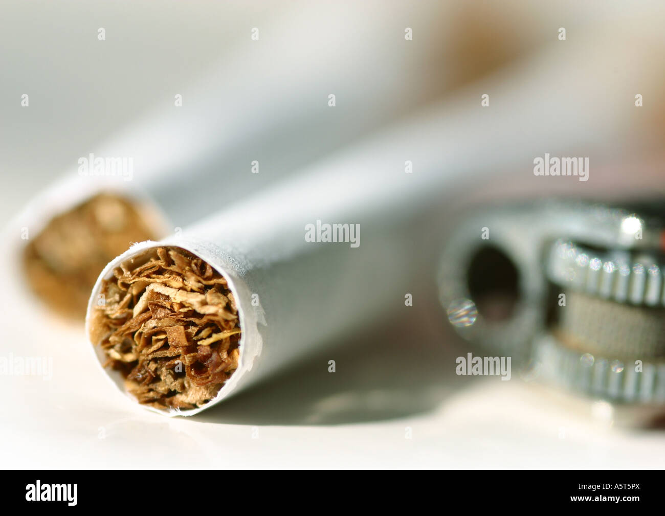 Cigarettes and lighter, extreme close-up - Stock Image