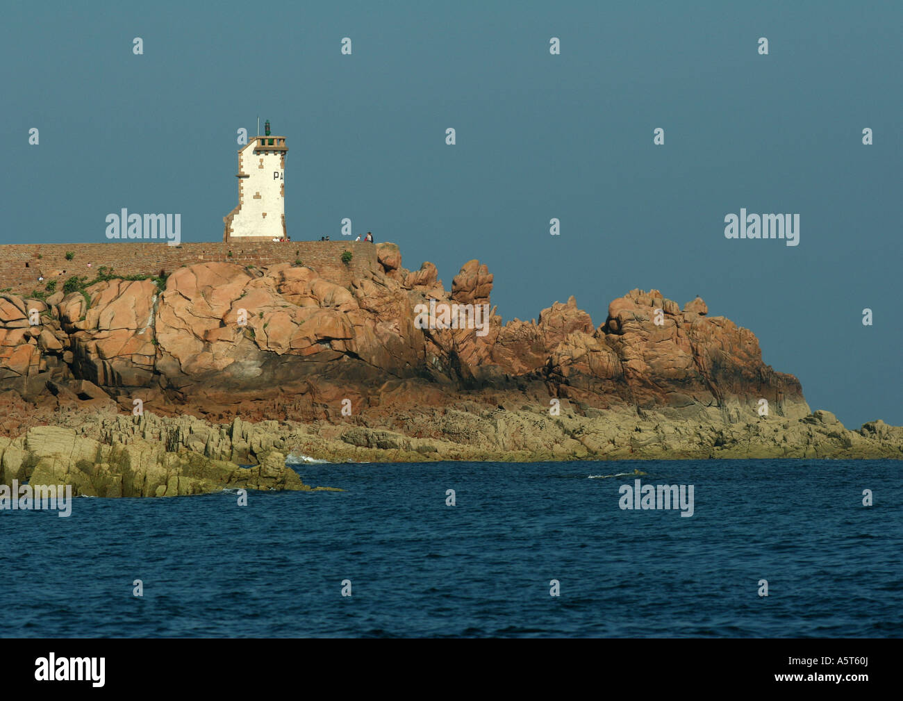 Ile de Brehat, Brittany, France, lighthouse and coastal rock formations - Stock Image