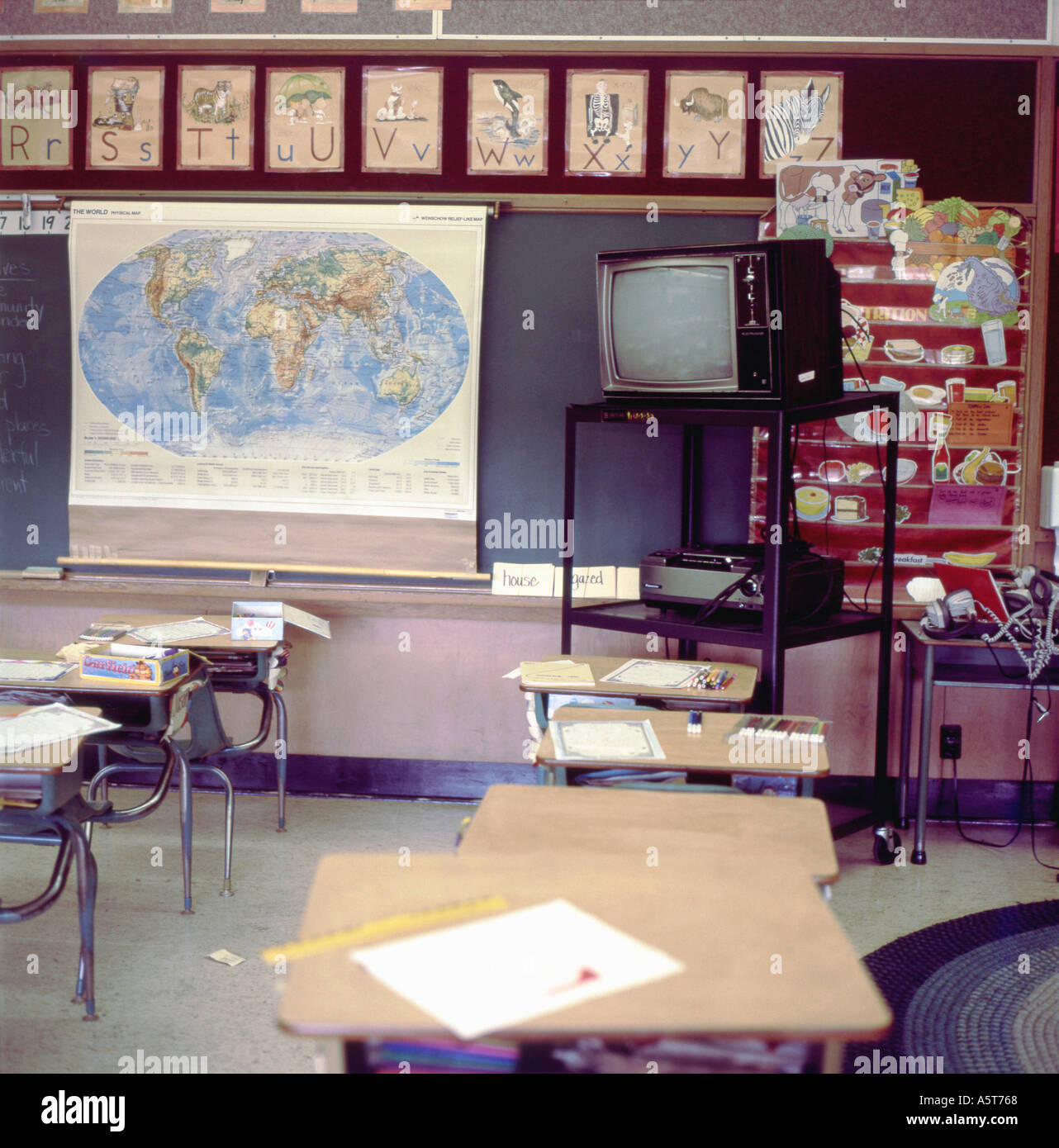 Map Of Canada For Elementary Students.Elementary Classroom Interior With Map On Blackboard Without