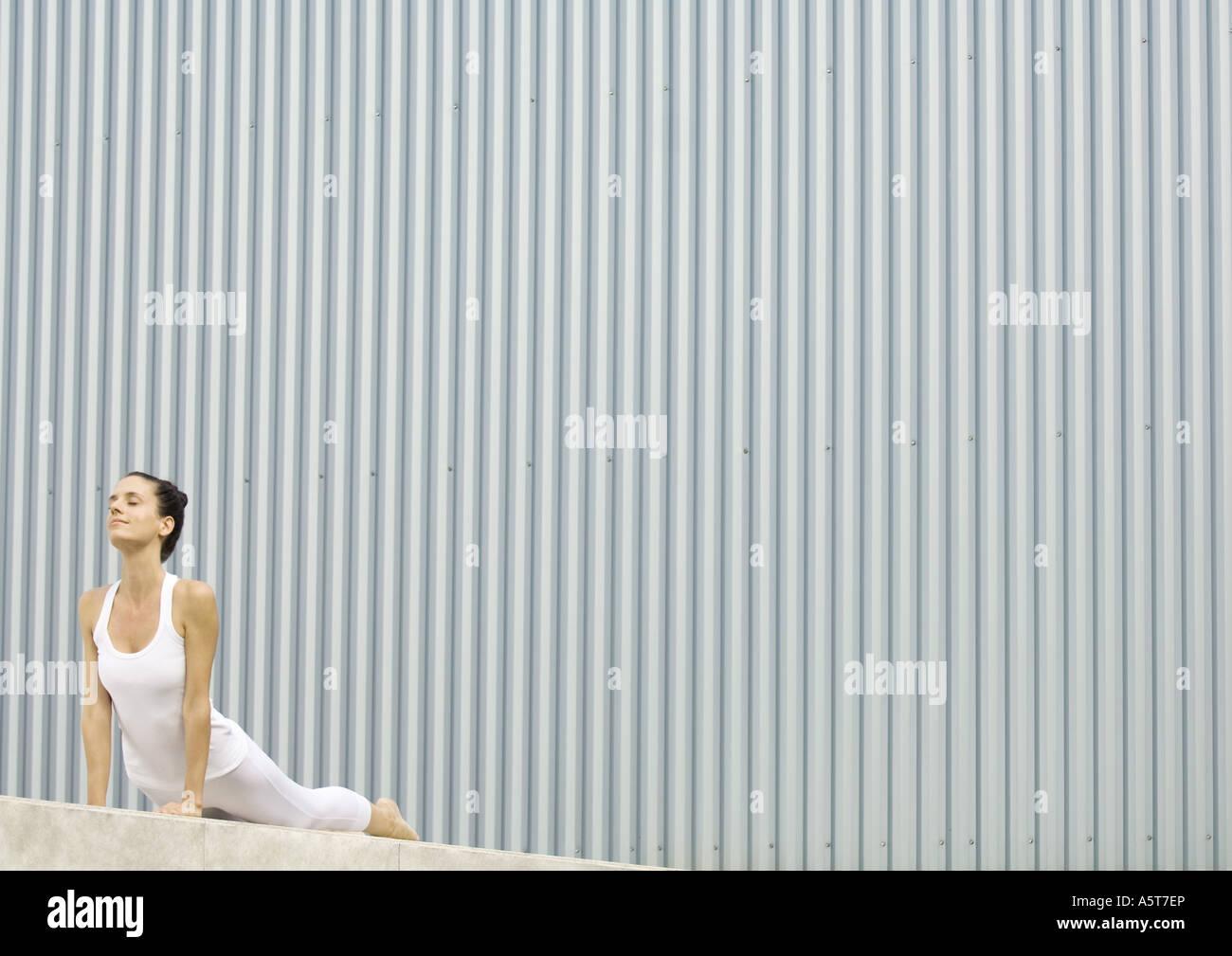 Woman doing cobra pose - Stock Image