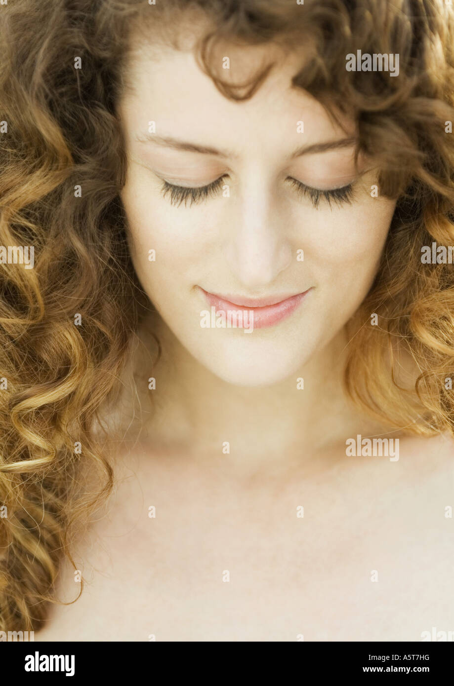 Woman, eyes closed, head and shoulders, close-up - Stock Image