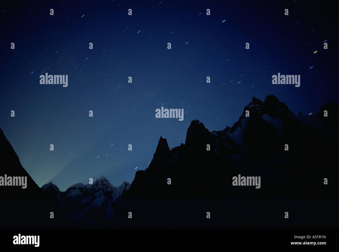Star tracks before moonrise Charakusa Valley Karakoram Himalaya Pakistan - Stock Image