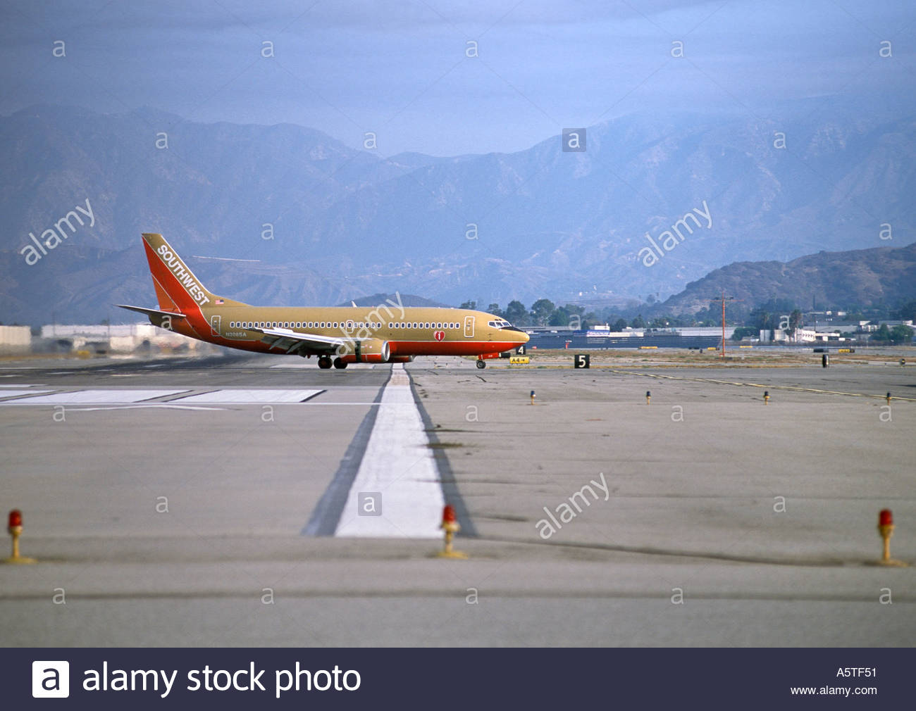 Commercial airliner on runway. - Stock Image