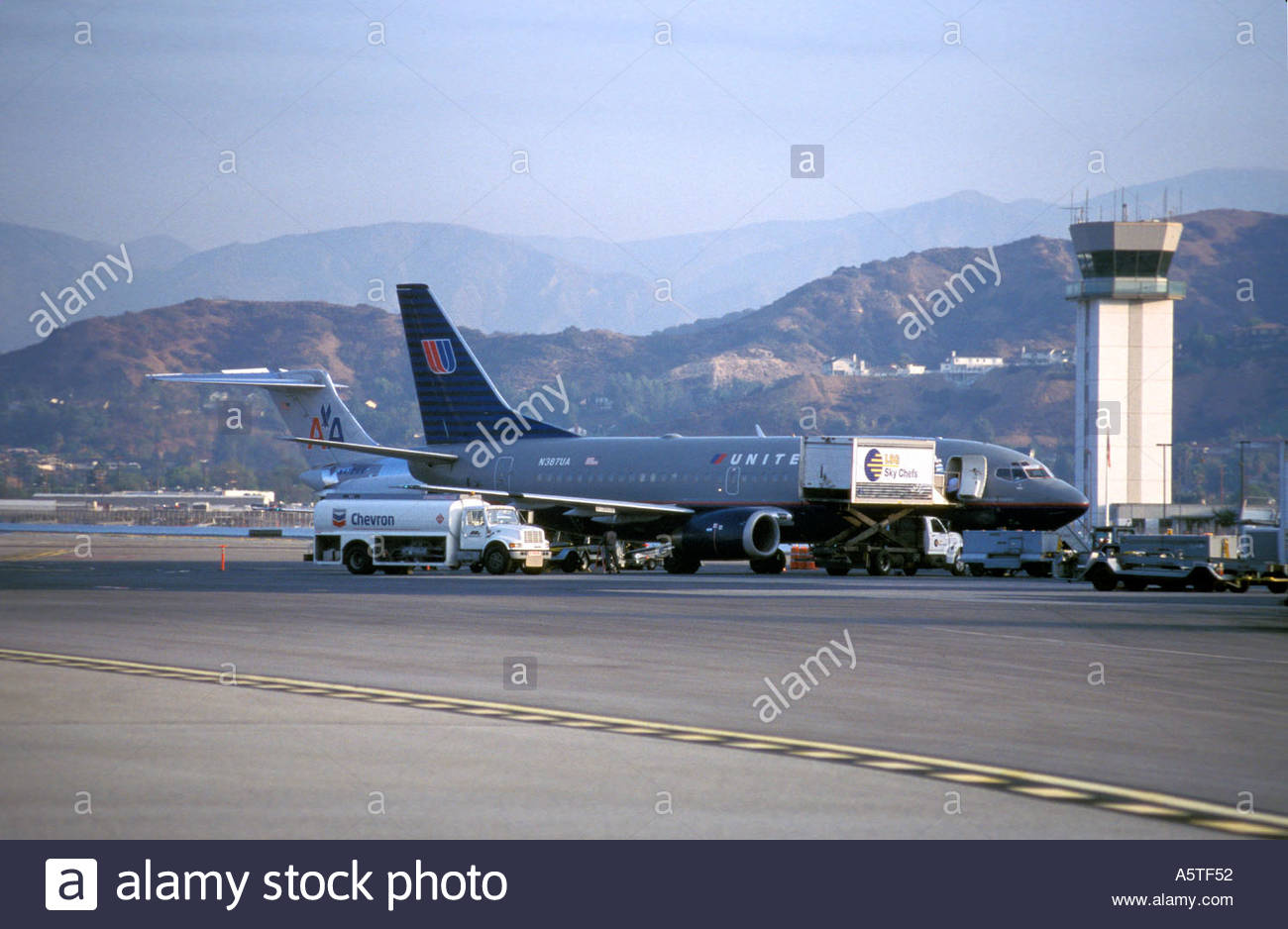 Commercial airliner being serviced at terminal. - Stock Image