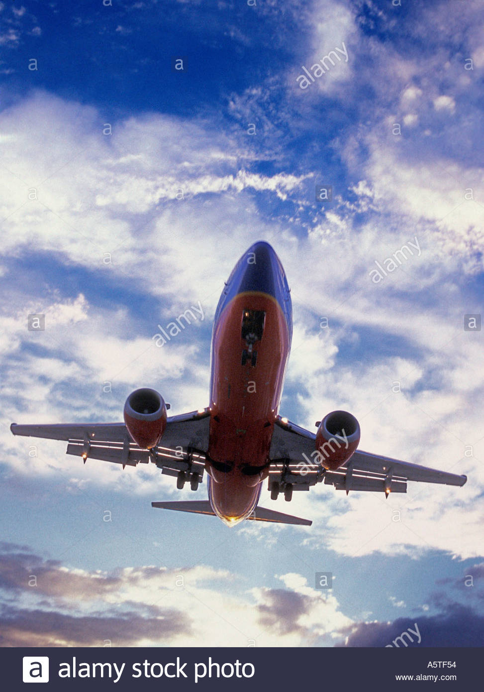 Commercial airliner in flight. - Stock Image