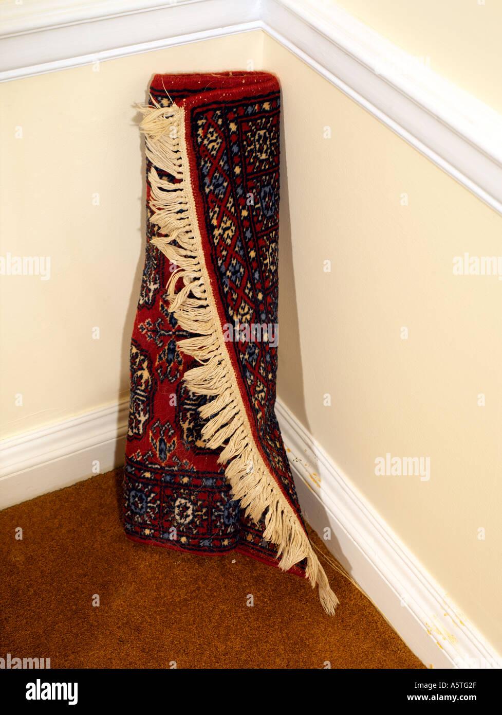 Prayer Rug in Corner of the Room - Stock Image