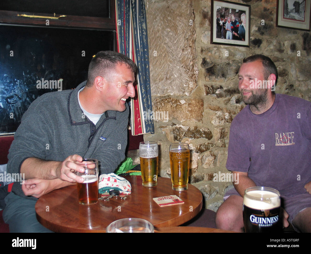 Doug Blane  and Dave (Archie) Archer having a few beers during a stag party weekend - Stock Image