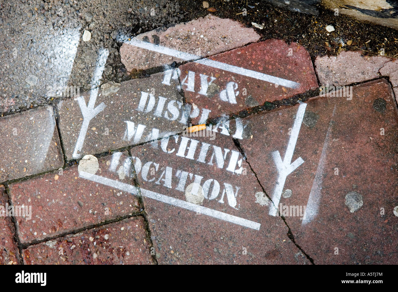 A pavement marked with paint to denote where a future pay and display machine is to be placed. Picture by Jim Holden. - Stock Image