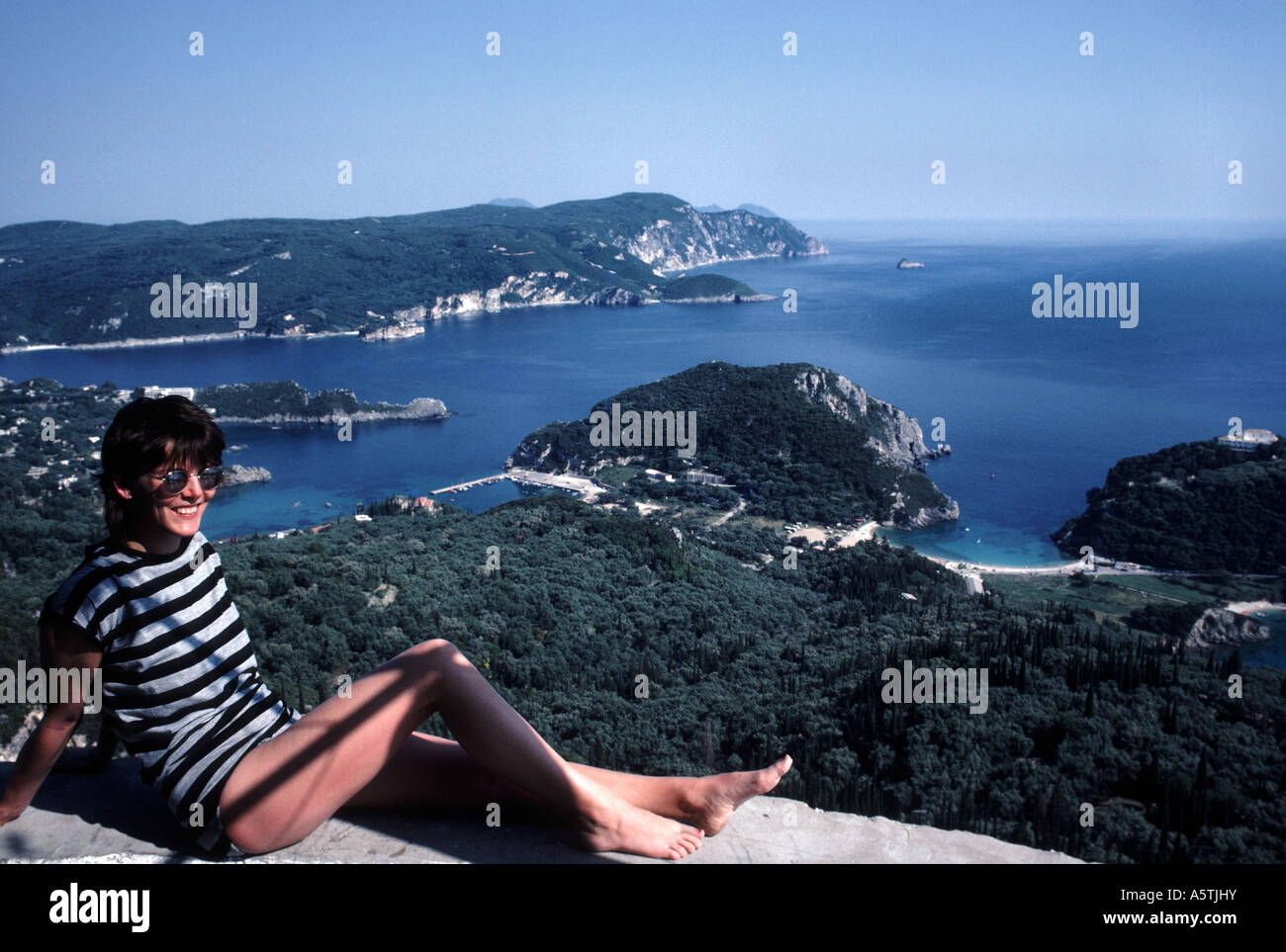 Sunbather Lakonnes overlooking Paleokastritsa Corfu Greece - Stock Image