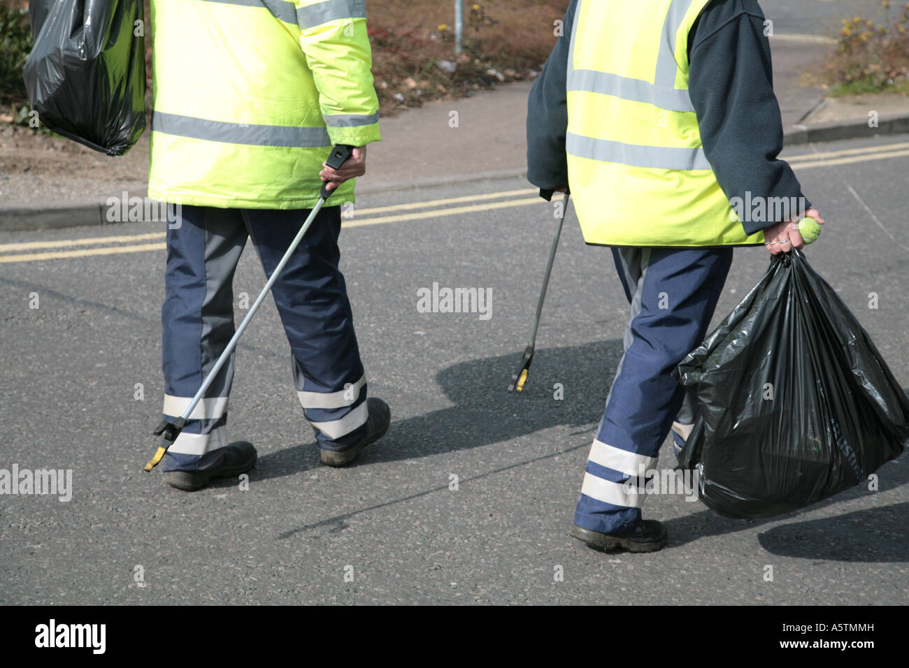 council workers collecting rubbish - Stock Image