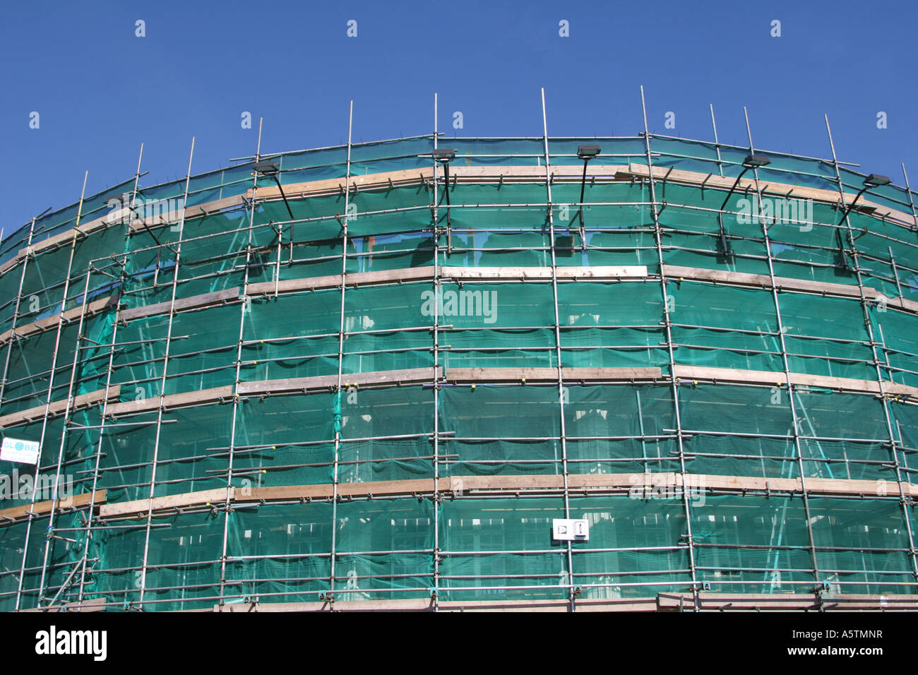 scaffolding with safety net - Stock Image