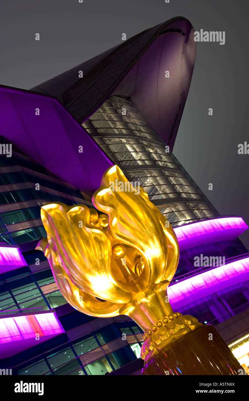 The Forever Blooming Golden Bauhinia Sculpture and Hong Kong Exhibition  Centre at Night, Wan Chai, Hong Kong, China - Stock Image