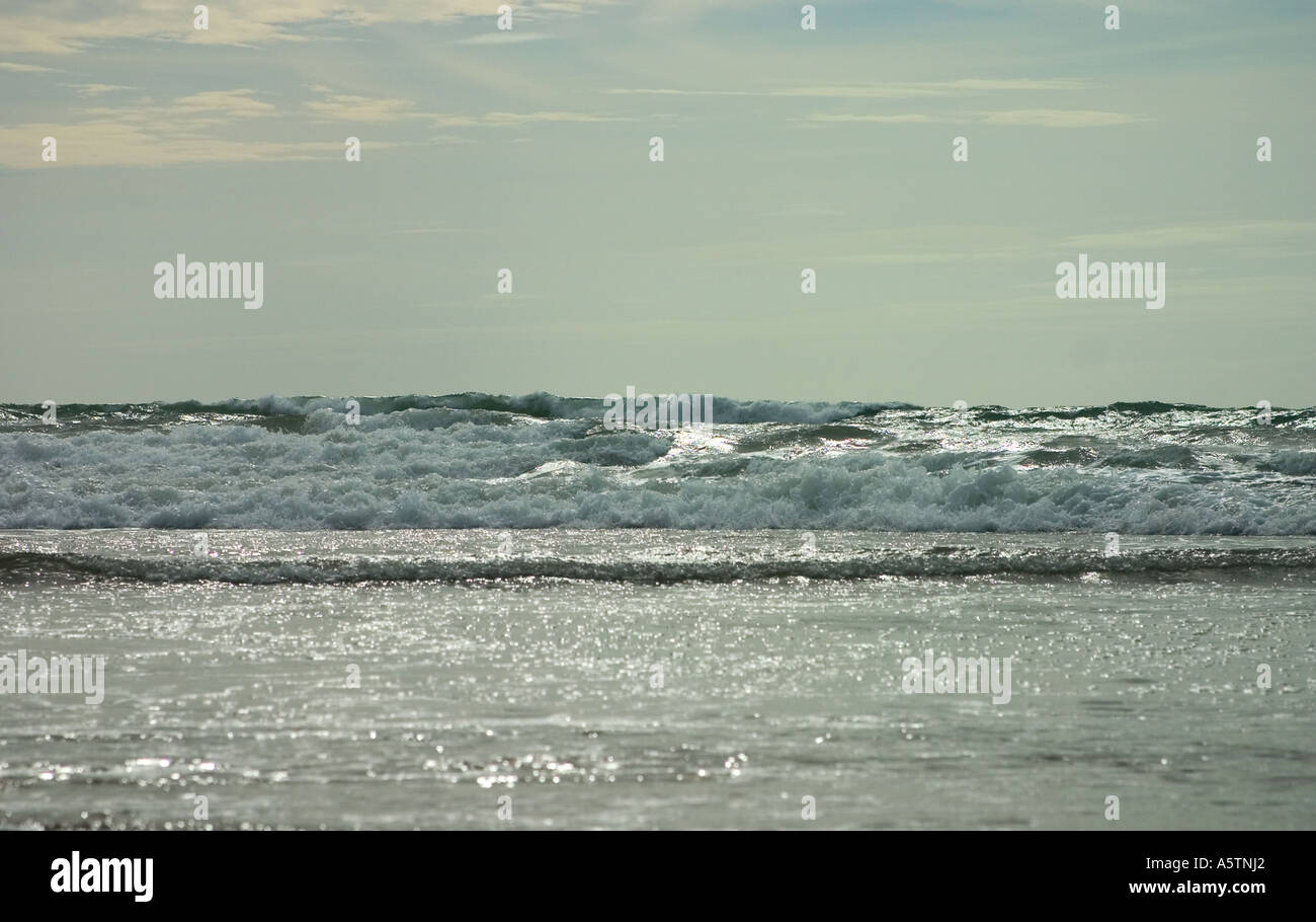 Shimmering light on rolling waves. - Stock Image