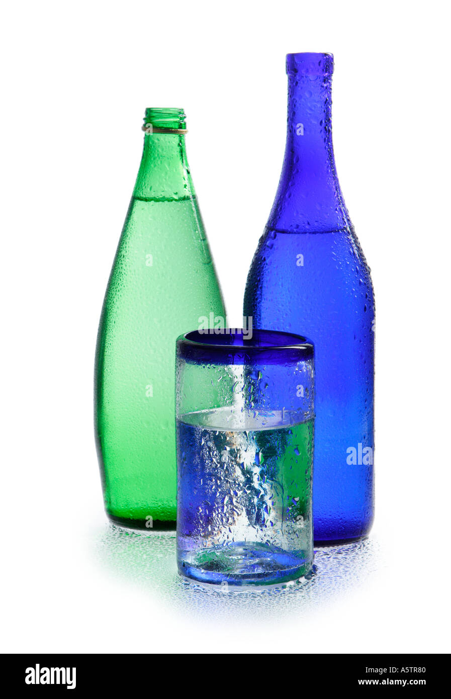 Blue and Green Water Bottles with glass of water - Stock Image