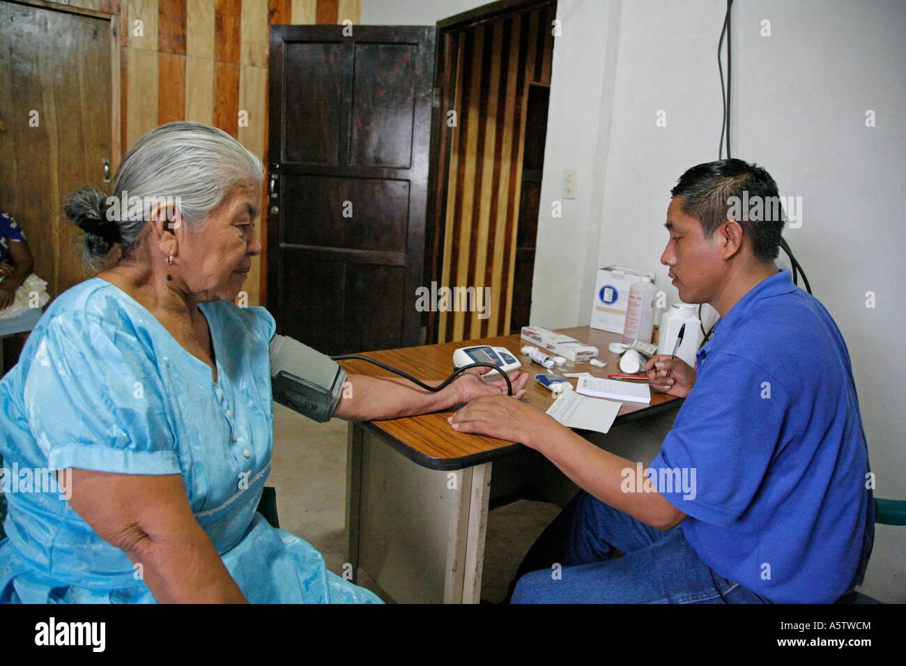 Painet jj1533 guatemala paramedic taking blood sample test sugar ...
