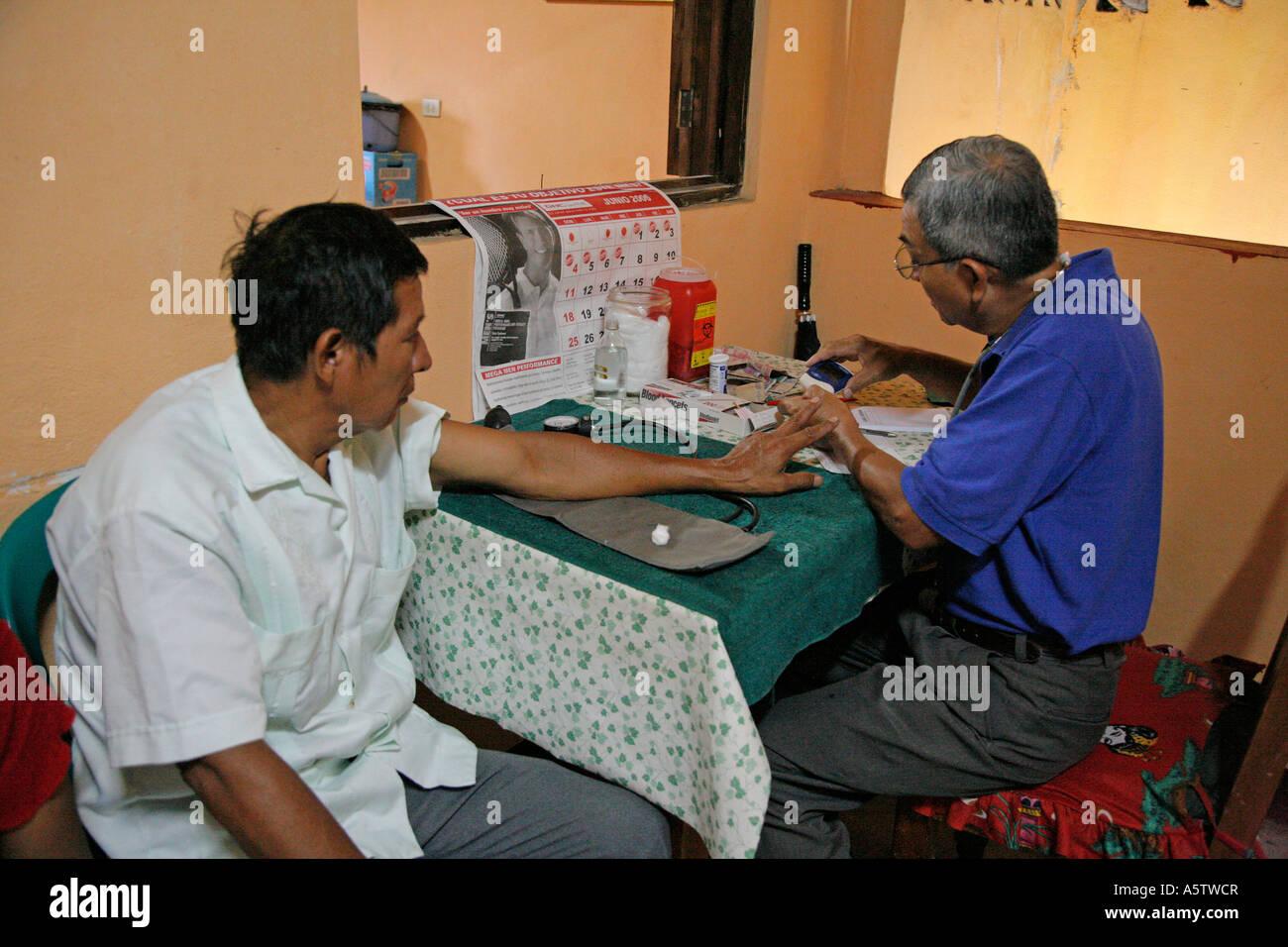 Painet jj1534 guatemala paramedic taking blood sample test sugar ...