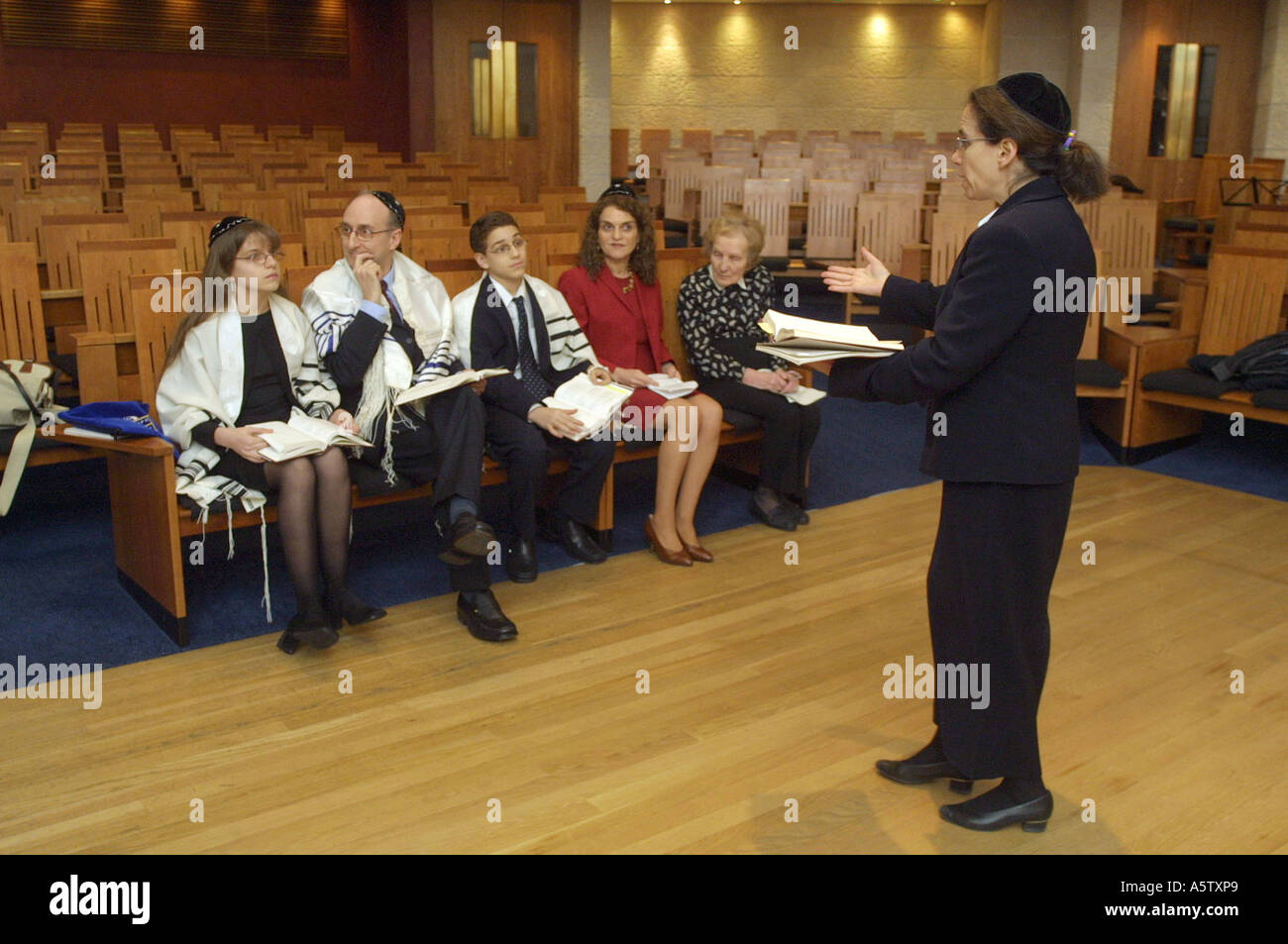 A woman rabbi rehearsing for a Bat Mitzva - Stock Image